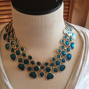 Gold and teal chocker necklace.